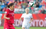 Canada's Christine Sinclair (12) chases the ball as New Zealand's Betsy Hassett (12) defends during second half action at FIFA World Cup in Edmonton, Alta., on Thursday June 11, 2015. THE CANADIAN PRESS/Jason Franson