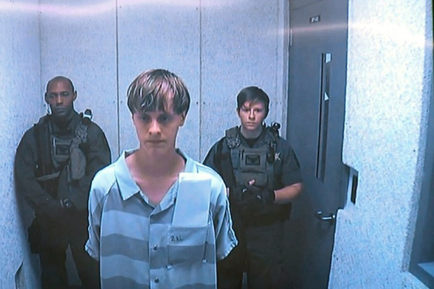 Accused in U S  church shooting indicted on dozens of