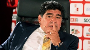 In this May 4, 2015 file photo, Argentina football legend Diego Maradona speaks on the second day of the SoccerEx Asian Forum conference in Southern Shuneh, Jordan. (AP Photo/Raad Adayleh, File)