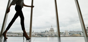 In this Sunday, Sept. 16, 2012 file photo, a model walks past a window with a view of St Paul's Cathedral during the presentation of the Matthew Williamson Spring/Summer 2013 collection at London Fashion Week. (AP /Alastair Grant)