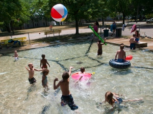 Children fill the Westown Park wading pool Thursday, July 5, 2012 in Grand Rapids, Mich.  (AP Photo/The Grand Rapids Press, Cory Morse)