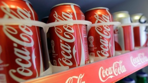 In this June 30, 2014 photo cans of Coca-Cola soda pop are shown in the refrigerator inside of Chile Lindo in San Francisco. (AP /Jeff Chiu)
