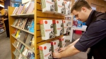 An Indigo employee puts books on a shelf in Toronto, on Thursday, November 25, 2010. (THE CANADIAN PRESS/Darren Calabrese)