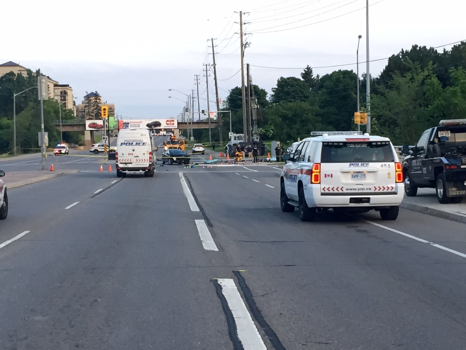 Police vehicles are seen on Dufferin Street in Concord following a collision that killed a cyclist on Monday, June 29, 2015. (CP24/Courtney Heels)