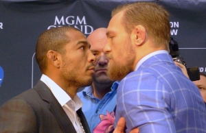 UFC featherweight champion Jose Aldo, left, of Brazil, and challenger (The Notorious) Conor McGregor, right, of Ireland, face off as UFC President Dana White looks on at the UFC 189 World Championship Tour in Toronto on Friday, March 27, 2015. (The Canadian Press/Neil Davidson)