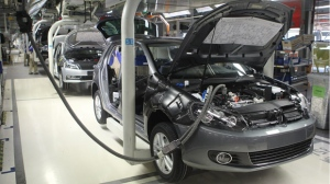 Cars roll through the assembly line at plant in Zwickau, Germany on April 25th, 2012. A robot at another Volkswagen plant in Germany grabbed and killed a contractor June 29. (THÜRINGEN PRESS)