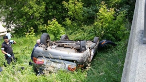 An image of the car that jumped a guardrail on Black Creek Drive Saturday afternoon, falling 15 feet into a creek bed. (Frank Graziano)