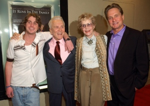 """In this April 7, 2003 file photo, actor Kirk Douglas, second from left, poses with his ex-wife Diana Douglas, second from right, their son Michael Douglas, right, and Michael's son Cameron Douglas, left, at a special screening of the film """"It Runs in the Family"""" in Los Angeles. (AP /Chris Pizzello)"""