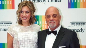 In this Dec. 7, 2013 file photo, Kennedy Center Honoree Billy Joel,right, and Alexis Roderick arrive at the Kennedy Center Honors gala dinner in Washington. Joel married girlfriend Alexis Roderick in a surprise ceremony at the couple's annual July 4 party. The singer's spokeswoman Claire Mercuri says New York Gov. Andre Cuomo presided over Saturday's nuptials at Joel's Long Island estate. (AP Photo/Kevin Wolf, File)