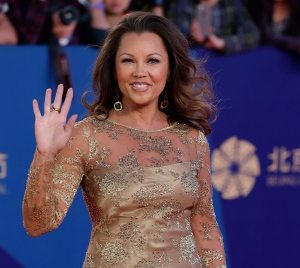 In a Thursday, April 23, 2015 file photo, Vanessa Williams waves as she arrives on the red carpet for the closing ceremony of the 5th Beijing International Film Festival in the Huairou district of Beijing. Saturday, July 4, 2015. (AP /Andy Wong)
