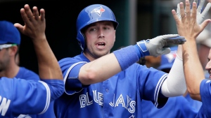 Toronto Blue Jays' Justin Smoak receives high-fives in the dugout after hitting a solo home run against the Detroit Tigers during the fifth inning of a baseball game Sunday, July 5, 2015, in Detroit. (AP /Duane Burleson)