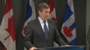 Mayor John Tory speaks with reporters at city hall on Monday.