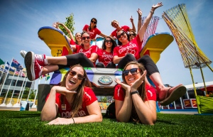 The Canadian women's water polo team poses for a picture on a giant chair inside the Pan American Games athletes village in Toronto, Friday July 3, 2015. THE CANADIAN PRESS/Mark Blinch