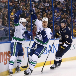 Vancouver Canucks center Shawn Matthias, center, and right wing Linden Vey, left, celebrate after Matthias scored in second period action during the NHL hockey game. At right is Blues defenceman Jay Bouwmeester. The Toronto Maple Leafs signed centre Matthias to a one-year contract Monday.The 27-year-old native of Mississauga, Ont., had 18 goals and nine assists in 78 games last season with the Canucks.THE CANADIAN PRESS/ AP/St. Louis Post-Dispatch.