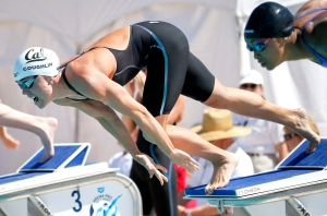 In this April 18, 2015, file photo, Natalie Coughlin dives off the starting block in a women's 200-meter freestyle preliminary race at the Arena Pro Swim Series meet in Mesa, Ariz. (AP Photo/Matt York, File)