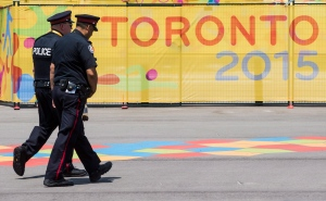 Police patrol inside the Pan American Games athletes village as security ramps before the games in Toronto, Friday July 3, 2015. THE CANADIAN PRESS/Mark Blinch