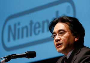 FILE - In this Jan. 31, 2013 file photo, Nintendo Co. President Satoru Iwata speaks during a news conference in Tokyo. (AP Photo/Koji Sasahara, File)