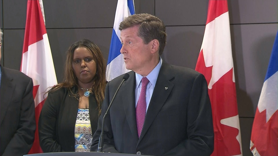 Mayor John Tory speaks with reporters after the release of a task force's interim report on the state of the TCHC.