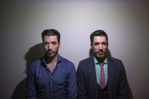 "Jonathan (left) and Drew Scott pose for a photo as they promote the television series ""Property Brothers"" in Toronto on Tuesday November 4, 2014. THE CANADIAN PRESS/Chris Young"