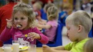 Aubrey Fischer and Briar Rave eat their lunch Thursday morning at Apple Tree Children's Center in Sioux Falls, S.D. May 23, 2013. (Argus Leader, Elisha Page / AP Photo)