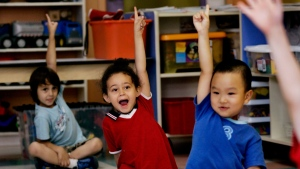 Children put up their hands for ice cream at a daycare centre in Montreal on Friday, Aug. 18, 2006. (The Canadian Press/Ian Barrett)