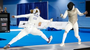 United States' Nicole Ross, right, competes against Canada's Kelleigh Ryan during their women's foil individual quarterfinal match at the Pan Am Games, Wednesday, July 22, 2015, in Toronto. (AP Photo/Julio Cortez)