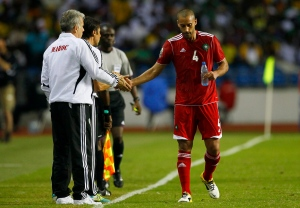 Morocco coach coach Eric Gerets, left shakes hands with defender Ahmed Kantari during their African Cup of Nations Group C soccer match against Gabon at Stade De L'Amitie in Libreville, Gabon, Friday, Jan. 27, 2012. (AP Photo/Francois Mori)