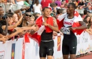 Andre De Grasse, of Canada, and teammate Brendon Rodney, right, celebrate with fans after the men's 4x100m rely final at the Pan American Games in Toronto on Saturday July 25, 2015. The Canadian men's 4x100-metre relay team was disqualified at the Pan American Games on Saturday, denying sprinter Andre De Grasse a third gold medal. THE CANADIAN PRESS/Frank Gunn
