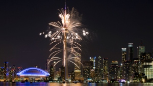 Fireworks explode from the CN Tower over downtown Toronto during the closing ceremonies of the Pan Am Games, Sunday, July 26, 2015. (AP /Rebecca Blackwell)