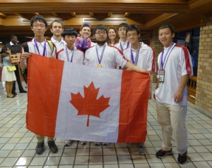 Left to right: Jinhao (Hunter) Xu, James Rickards (Observer), Kevin Sun, Jacob Tsimerman (Leader), Zhuo Qun (Alex) Song, Lindsey Shorser (Deputy Leader), Alexander Whatley, Michael Pang, Yan (Bill) Huang are shown at the International Mathematical Olympiad in Thailand on July 16, 2015. THE CANADIAN PRESS/HO-Canadian Mathematical Society