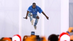 Kanye West performs during the closing ceremony of the 2015 Pan Am Games in Toronto on Sunday, July 26, 2015. Organizers say taxpayers aren't footing the bill for Kanye West's headlining performance at the Pan Am Games closing ceremony on Sunday. THE CANADIAN PRESS/Mark Blinch