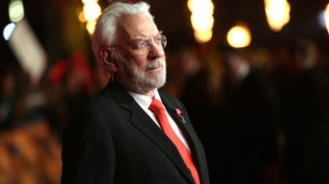 Actress Donald Sutherland poses for photographers upon arrival to the world premiere of the film The Hunger Games Mockingjay Part 1 in London, Monday, Nov. 10, 2014. (Photo by Joel Ryan/Invision/AP)