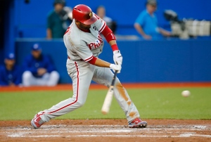 Philadelphia Phillies' Andres Blanco hits an RBI double against the Toronto Blue Jays during the fifth inning of MLB interleague baseball action in Toronto on Tuesday, July 28, 2015. (The Canadian Press/Mark Blinch)