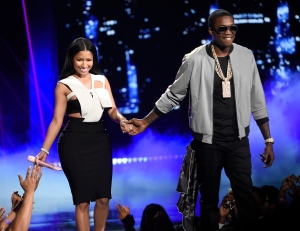 FILE - In this Sunday, June 28, 2015, file photo, Nicki Minaj, left, and Meek Mill perform at the BET Awards at the Microsoft Theater in Los Angeles. The war of the words continues between rappers Meek Mill and Drake. Mill commented Sunday, July 28, 2015, on a song released by Drake while performing at the Barclays Center in Brooklyn, where he was opening on tour for his girlfriend, Nicki Minaj. (Photo by Chris Pizzello/Invision/AP, File)