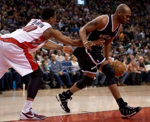 Toronto Raptors guard DeMar DeRozan (left) fouls Brooklyn Nets forward Jerry Stackhouse during first half NBA action in Toronto on Sunday April 14, 2013. THE CANADIAN PRESS/Frank Gunn