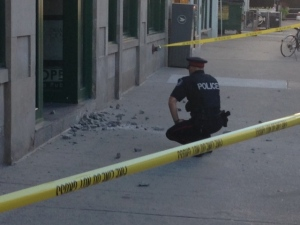 Police say concrete that fell from downtown building may have been thrown