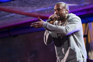In this Dec. 1, 2014 file photo, Kanye West performs during the World AIDS Day (RED) concert In Times Square in New York. West, Sam Smith, Janet Jackson and the Who are some of the A-Listers set for the iHeartRadio Music Festival this fall. IHeartMedia announced Thursday, July 30, 2015, that Lil Wayne, Coldplay, the Weeknd and Blake Shelton will also perform during the two-day event in Las Vegas on Sept. 18-19. (Photo by Charles Sykes/Invision/AP, File)
