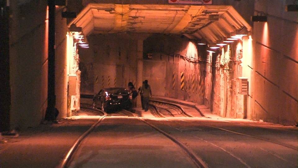 A vehicle is seen stuck inside a streetcar tunnel on Queens Quay on July 31, 2015.