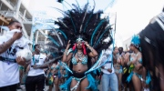 A masquerade band reveler fixes her headdress during the Scotiabank Toronto Caribbean Carnival grand parade in Toronto on Saturday, August 1, 2015. THE CANADIAN PRESS/Giordano Ciampini