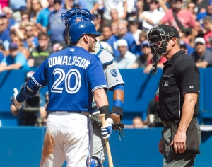 Toronto Blue Jays Josh Donaldson complains to home plate umpire Jim Wolf after he was brushed back by a pitch for the third time in the game during eighth inning AL baseball action between the Blue jays and Kansas City Royals in Toronto on Sunday August 2, 2015. THE CANADIAN PRESS/Fred Thornhill