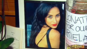 Ariela Navarro-Fenoy is seen in a framed photograph at a memorial event.