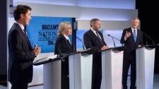 Liberal leader Justin Trudeau, Green Party leader Elizabeth May and New Democratic Party leader Thomas Mulcair listen as Conservative Leader Stephen Harper take part in the first leaders debate Thursday, August 6, 2015 in Toronto. THE CANADIAN PRESS/Frank Gunn