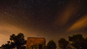 "Stars seen as streaks from a long camera exposure are seen behind Arnotegui Hermitage, in Obanos, northern Spain, Tuesday, Aug. 11, 2015. Some Catholics refer to the Perseids as the ""tears of Saint Lawrence"", since 10 August is the date of that saint's martyrdom. (AP /Alvaro Barrientos)"