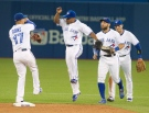 Toronto Blue Jays' Ben Revere, left to right, Ryan Goins, Kevin Pillar and Troy Tulowitzki celebrate after they defeated the Oakland Athletics 10-3 in their AL baseball game in Toronto on Wednesday August 12, 2015. THE CANADIAN PRESS/Fred Thornhill