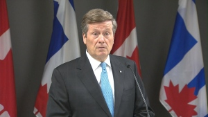 Mayor John Tory speaks with reporters at city hall on Thursday morning.