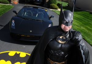 In this March 27, 2012, photo, Leonard Robinson, dressed as Batman, poses for a photo outside his home, in Owings Mills, Md. Authorities say, Robinson, known for visiting hospitalized children dressed in his Batman costume, died, Sunday, Aug. 16, 2015, in a crash on Interstate 70, in western Maryland. Police say Robinson was checking the engine of his Batmobile while standing in the fast lane of eastbound I-70 Sunday night when the car with hit by a Toyota Camry. The driver of the Camry wasn't injured. (Jonathan Newton/The Washington Post via AP)