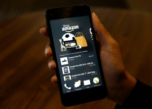 FILE - This June 18, 2014 file photo shows the app that links to shopping on Amazon.com on the new Amazon Fire Phone, in Seattle. (AP Photo/Ted S. Warren, File)