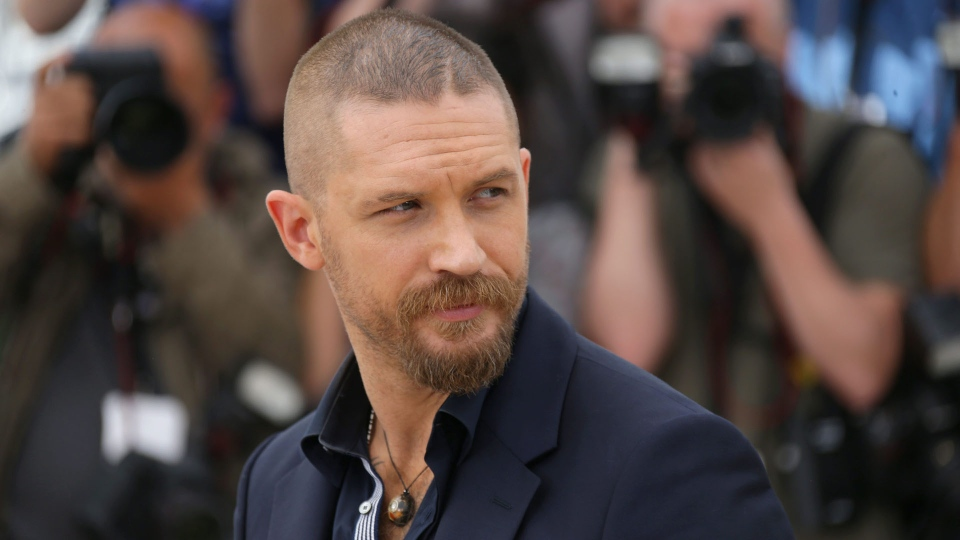 Tom Hardy poses for photographers during a photo call for the film Mad Max : Fury Road, at the 68th international film festival, Cannes, southern France, Thursday, May 14, 2015. (Joel Ryan/Invision/AP)
