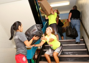 Students help to carry the belongings of the first year students up the stairs, as they move into their residences at The University of Western Ontario in London, Ont., Sunday, September 4, 2011. THE CANADIAN PRESS/Dave Chidley