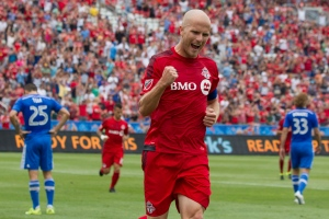 Toronto FC 's Michael Bradley, centre, celebrates scoring his team's first half goal against the Montreal Impact during first half MLS action in Toronto on Saturday, August 29, 2015. (Chris Young /The Canadian Press)